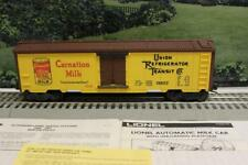 LIONEL- 19802-   OPERATING CARNATION MILK CAR - COMPLETE- NEW- WRONG BOX - R1G