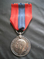 GEORGE V IMPERIAL SERVICE SILVER MEDAL WITH RIBBON AND FIXING BAR