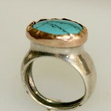 A Silver Ring with Turquoise Gemstone Set in 14K Rose Gold Wrap. Israeli jewelry
