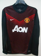 MANCHESTER UNITED OFFICIAL LONG SLEEVED TRAINING TOP BY  NIKE  SIZE MEDIUM
