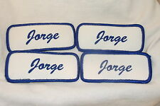 JORGE  LOT OF 4 USED SILK SCREEN NAME PATCH TAGS ASSORTED COLORS