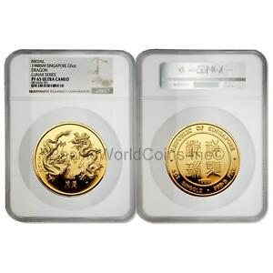 Click now to see the BUY IT NOW Price! SINGAPORE 1988 DRAGON 5 OZ GOLD NGC PF65 ULTRA CAMEO