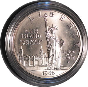 1986 STATUE OF LIBERTY UNCIRCULATED SILVER DOLLAR WITH ORIGINAL PACKAGING.