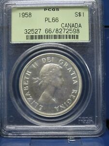 Click now to see the BUY IT NOW Price! 1958 $1 CANADA SILVER DOLLAR ELIZABETH II DOLLAR BLAST WHITE PCGS PL66