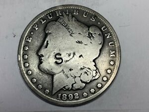 1892 MORGAN DOLLAR COUNTER STAMPED 'S' ON FRONT AND 'SOS' ON BACK