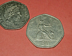 OLD 50 PENCE. ISSUED 1969.  LARGER THAN CURRENT COINS  BRITANNIA. CIRCULATED
