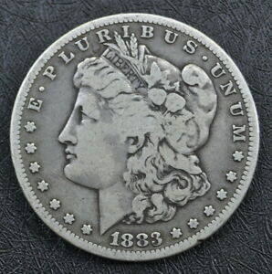 1883 S MORGAN SILVER DOLLAR AN HONEST UNGRADED COIN WITH FREE U.S. SHIPPING