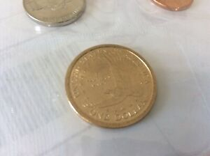 2002D UNCIRCULATED SACAGAWEA DOLLAR  AND HER INFANT SON