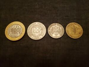 WEST AFRICA CFA LOT OF 4 CIRCULATED COINS. 1979 TO 2005. MIXED COMPOSITION.