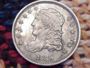 1835 CAPPED BUST HALF DIME.  GRADES IN THE AU RANGE.