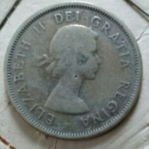 1957 CANADIAN QUARTER   SILVER GOOD CONDITION NOT STOCK PHOTO