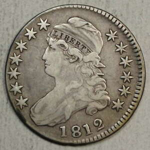 1812 CAPPED BUST HALF DOLLAR STRUCK SLIGHTLY OFF CENTER     0214 23