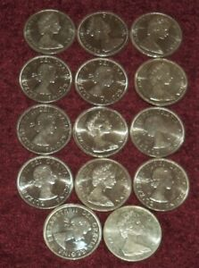 Click now to see the BUY IT NOW Price! 14 GEM QUEEN ELIZABETH II CANADA .800 SILVER $1 COINS: 1963  1967; 328 GMS TW