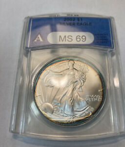 2002 AMERICAN SILVER EAGLE ANACS MS 69 NICELY TONED.