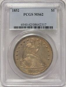 Click now to see the BUY IT NOW Price! 1852 SEATED LIBERTY SILVER DOLLAR   PCGS MS 62 CERTIFIED COIN   JY022
