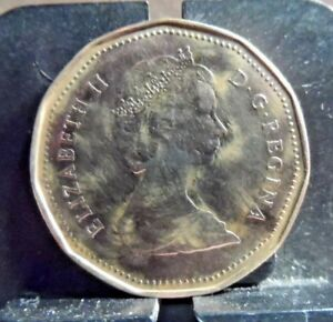 CIRCULATED 1987 ONE DOLLAR CANADIAN COIN  122218 1 ..FREE DOMESTIC SHIPPING