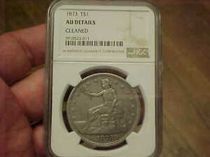 1873 P US TRADE SILVER DOLLAR NGC AU DET FULL LIBERTY MOTTO FEATHERS TONE