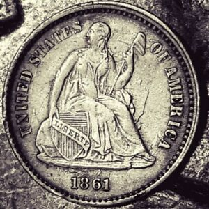 1861 SEATED LIBERTY HALF DIME. STRUCK WITH CLASHED DIES. MARKS ON BOTH SIDES.
