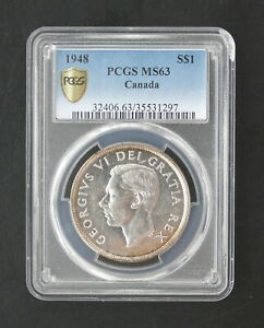 Click now to see the BUY IT NOW Price! 1948 1 DOLLAR GEORGE VI SILVER CAN  PCGS GRADE MS 63