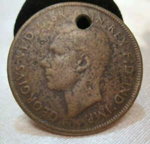 AUSTRALIAN PENNY COPPER 1943 WITH AN WHOLE DRILLED IN IT FOR A KEY CHAIN OR ?