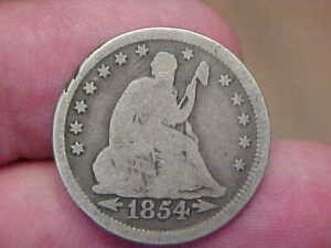 1854 P SEATED LIBERTY QUARTER WITH ARROWS FULL RIM DATE LETTERING TONED