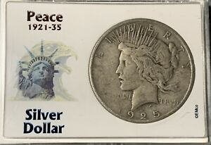 1925 PEACE SILVER DOLLAR IN A COLLECTORS CASE.