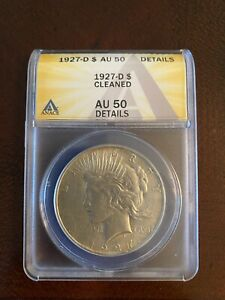1927 D LIBERTY SILVER DOLLAR CLEANED AU 50