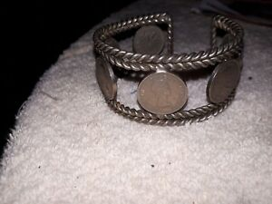 Click now to see the BUY IT NOW Price! 1953 CANADIAN PENNY BRACELET WITH 6 SHOULDER FOLD 1953 PENNIES