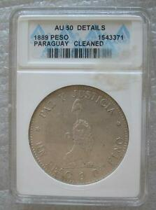 Click now to see the BUY IT NOW Price! PARAGUAY 1 PESO 1889 SILVER CROWN ANACS AU50 LION