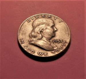 1957 D  FRANKLIN    90   SILVER  LITTLE SOILED FEELING.