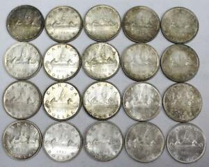 Click now to see the BUY IT NOW Price! 20X 1953 CANADA SILVER DOLLARS QUEEN ELIZABETH II ONE ROLL 20 COINS EF45 AU55