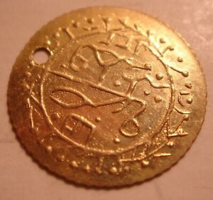 UNKNOWN TINY GOLD COLORED COIN