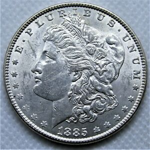 UNCIRCULATED 1885 MORGAN SILVER DOLLAR. BU WITH GREAT LUSTER AND NICE TONING