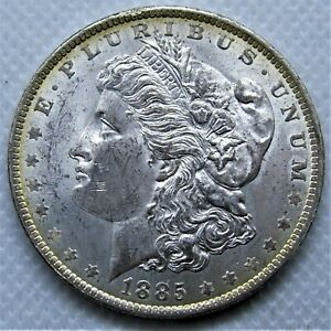 UNCIRCULATED 1885 O MORGAN SILVER DOLLAR. BU WITH GREAT LUSTER AND NICE TONING