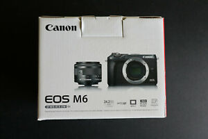 CANON EOS M6 W/15 45MM LENS AND DSLR LENS ADAPTER  SILVER