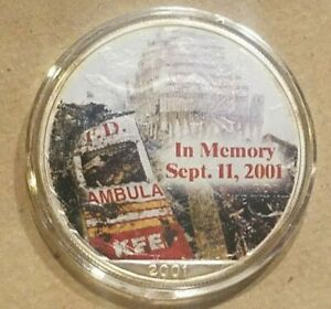Click now to see the BUY IT NOW Price! 2001 AMERICAN SILVER EAGLE 9/11 NYFD AMBULANCE NEW YORK EMT COLORIZED $1 COIN