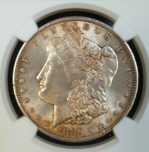Click now to see the BUY IT NOW Price! 1885 O MORGAN SILVER DOLLAR NGC MS64 RETAINED LAMINATION MINT ERROR TONED