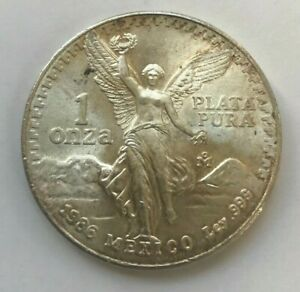 Click now to see the BUY IT NOW Price! 1986 MEXICO LIBERTAD ONZA 1 OZ SILVER ROUND   UNCIRCULATED