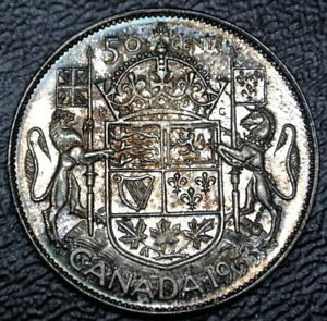 Click now to see the BUY IT NOW Price! OLD CANADIAN COIN 1953 NSF   50 CENTS   .800 SILVER   ELIZABETH II   NICE TONING