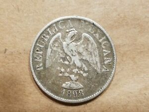 Click now to see the BUY IT NOW Price! 1898 MO M MEXICO 20 CENTAVOS SILVER MEXICAN 1/5 PESO COIN NICE
