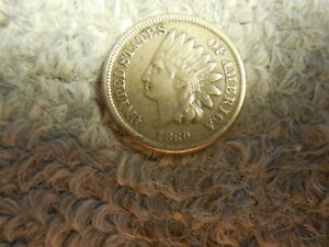 1860 CN INDIAN HEAD CENT IN ABOUT VF XF CONDITION. BUT YOU DECIDE