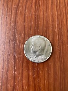 1776 1976 KENNEDY HALF. THIS IS THE COIN YOU WILL RECEIVE