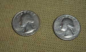 PAIR OF 1976 BICENTENNIAL QUARTERS ONE WITH FILLED IN D ERROR