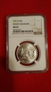 1991 D MOUNT RUSHMOOR NGC 69 COMMEMORATIVE HALF DOLLAR COIN. NGC VALUED AT 24.15