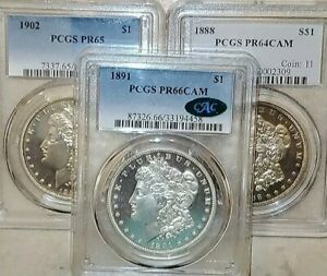Click now to see the BUY IT NOW Price! [LOT OF 3] PROOF MORGANS  1891 PCGS PR66CAM  1902 PCGS PR65  1888 PCGS PR64CAM