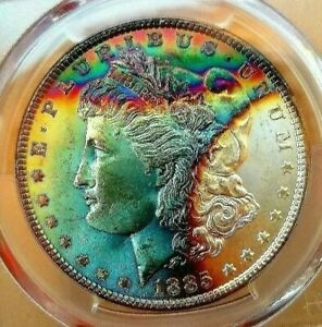 Click now to see the BUY IT NOW Price!   PCGS MS65   1885  MORGAN DOLLAR  INCREDIBLE RAINBOW TONED CROWN ME JEWELS