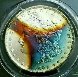 Click now to see the BUY IT NOW Price!   PCGS MS65   1884 O  MORGAN DOLLAR  INCREDIBLE RAINBOW TONED THE STARGAZER