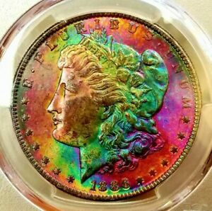 Click now to see the BUY IT NOW Price!   PCGS MS 63   CAC    1886 MORGAN DOLLAR  AMAZING RAINBOW GREEN HAIR LADY