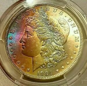Click now to see the BUY IT NOW Price!   PCGS MS64    1884 O  MORGAN DOLLAR  AMAZING RAINBOW TONED INFLAMED