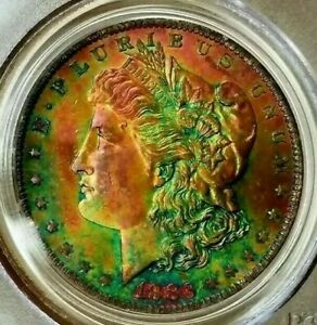 Click now to see the BUY IT NOW Price!   PCGS MS64  CAC    1883 O  MORGAN DOLLAR   GREENY GOLD DIGGER